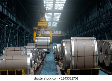 Roll of steel sheet in a plant, picjked up by crane