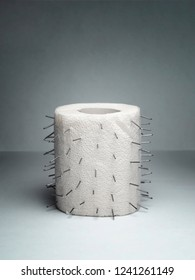 A roll of toilet paper with thorns. Unusual joke. Treatment of hemorrhoids