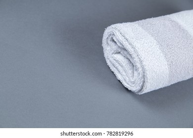 roll towels with brush on gray background