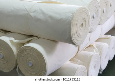 roll of white fabric for cutting