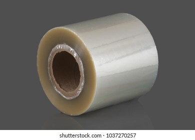 Roll of wrapping plastic stretch film. Close-up with Shallow Depth of Field. Isolated on gray background.