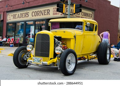 ROLLA, MISSOURI JUNE 6, 2015  Rolla Summerfest Car Show - Yellow hot rod restored for show