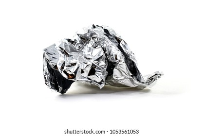 Rolled up ball of use aluminum foil