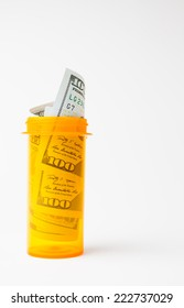 Rolled banknotes in prescription bottle concept