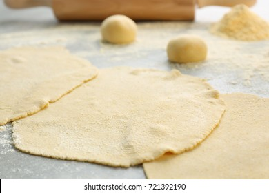 Rolled dough for tortillas on kitchen table