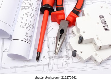 Electrical blueprint imgenes fotos y vectores de stock shutterstock rolled electrical diagrams electric fuse and work tools lying on construction drawing of house malvernweather Choice Image
