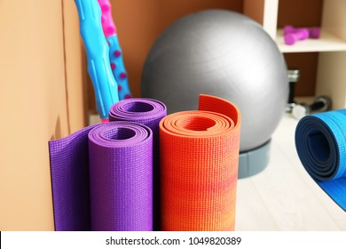 Rolled fitness mats in physiotherapy gym, closeup