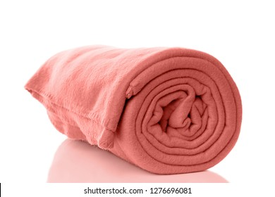 rolled up fleece blanket in coral trend color of the year 2019