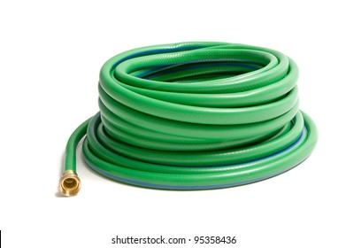 Rolled garden hose isolated on white
