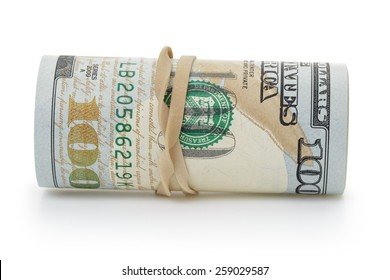 rolled hundred dollar banknotes tied with rubberband