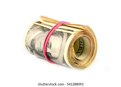 rolled into a tube bundle of paper dollars and drag a rubber band