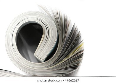 Rolled magazine isolated on white background with copy space.