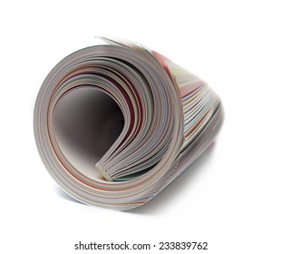 Rolled up magazine on white