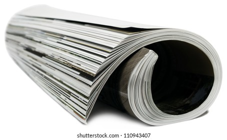 Rolled magazine on white background.
