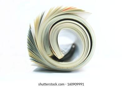 Rolled magazine on white background