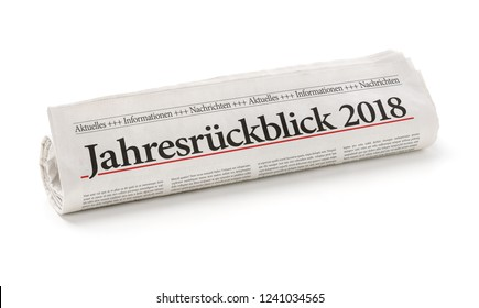 Rolled newspaper with the german headline Jahresrueckblick 2018 - Annual review 2018