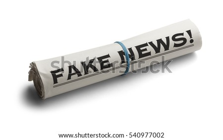 Rolled Up Newspaper with Headline of Fake News Isolated on White Background.