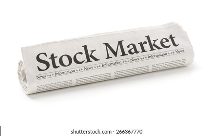 Rolled newspaper with the headline Stock Market