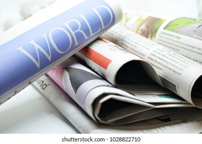 Rolled newspaper with the headline world news