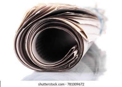 Rolled Newspaper on tablet
