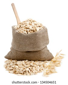 Rolled oats in a bag isolated on white background