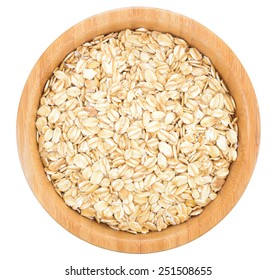 Rolled oats in wooden bowl isolated on white background.