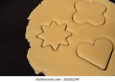 Rolled out pastry with cutted shapes for cookies