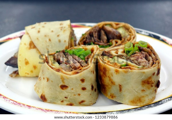 Rolled pancakes stuffed with beef, spring onions and sweet bean sauce is a popular Chinese snack