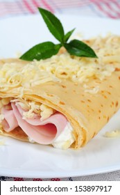 rolled pancakes stuffed ham and cheese