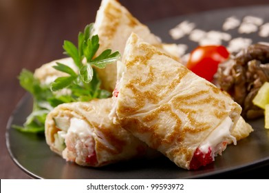 rolled pancakes stuffed . Shallow depth-of-field.