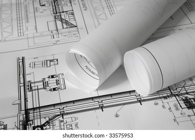Rolled plans on the table