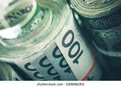 Rolled Polish Zloty Banknotes Closeup Photo. Polish Financial Concept.