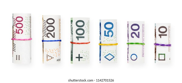 Rolled with a rubber polish zloty banknotes isolated on white background with clipping path