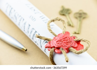 Rolled up scroll of Last will and testament that fastened with natural brown jute twine hemp rope, sealed with sealing wax and stamped with alphabet letter B. Decorated with two antique brass keys.
