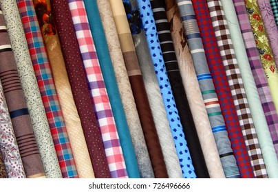 Rolled Shirt cloth or textile in Road side Retail shop or store in the market in India for use as background