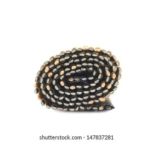 Rolled straw mat isolated over white background, side view