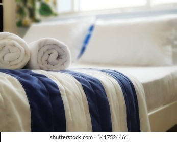 rolled up towel and clean sheets. used for airbnb advertising
