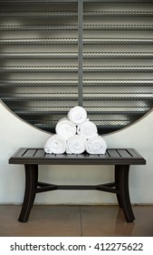 Rolled towels on a table