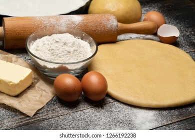 rolled and unbaked Shortcrust pastry dough recipe on wooden background