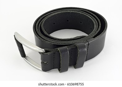 rolled up used black leather belt with metallic buckle without a  pin
