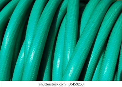 Rolled up water hose