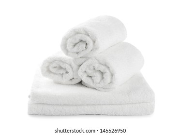 rolled up white beach towel isolated on  white background