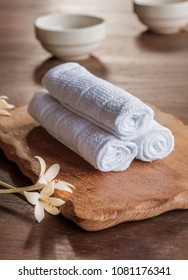 Rolled up white spa towels, selective focus, vintage