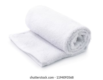 Rolled up white terry towel isolated on white