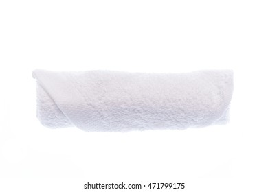rolled up white towel on white background
