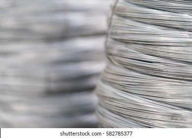 Rolled wire production in factory. Close up stack of wire rod mesh inside the factory ready to be manufactured to be product