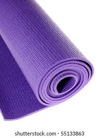 a rolled up yoga or pilates exercise mat isolated on white.