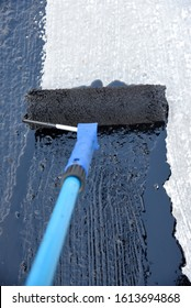 Roller brush waterproofing. Waterproofing coating. Copy space. Space for text.  closeup