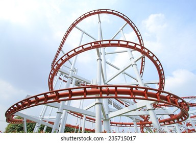 Roller coaster with blue sky background in theme park