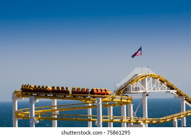 Roller Coaster on Clear Sky and Ocean Background with American Flag